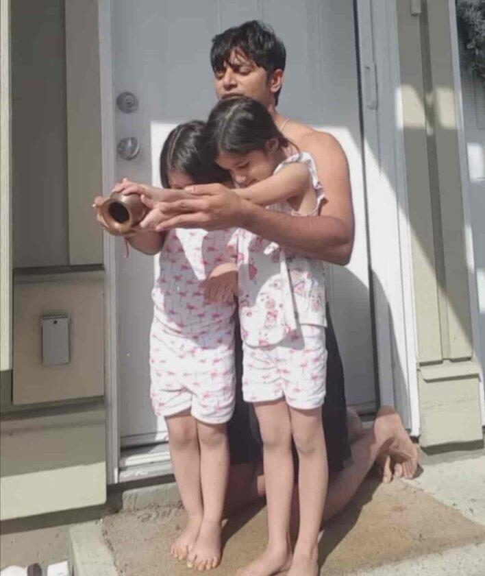 Karanvir Bohra with his twin daughters